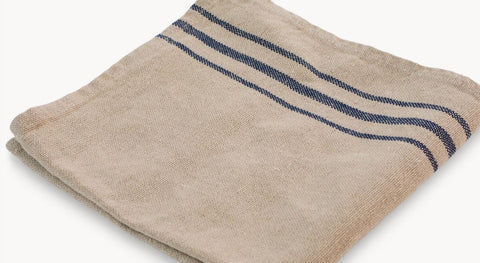 Rustic linen napkin with blue stripes