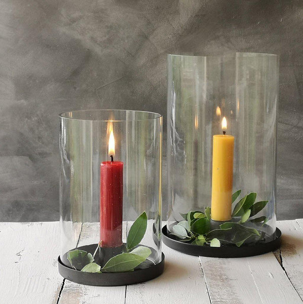 simple glass hurricane with zinc candle holder base