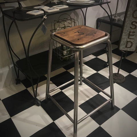set of three iron and wood bar stools