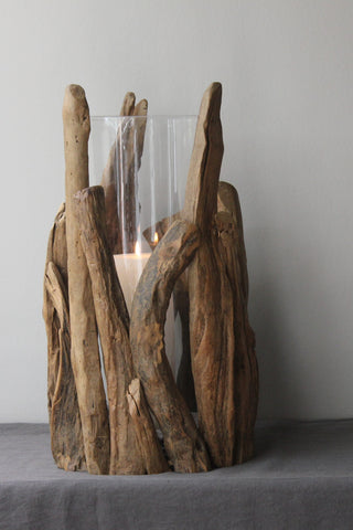 tall driftwood and glass hurricane lamp or vase
