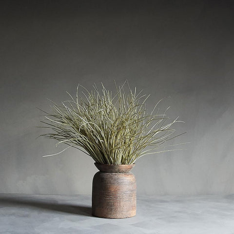 rustic ceramic vase emulating wood