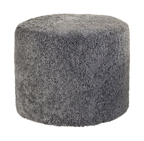grey round short-haired sheepskin pouf or footstool
