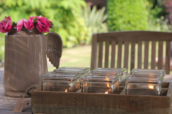 Rustic wooden tray with glass tealight holders