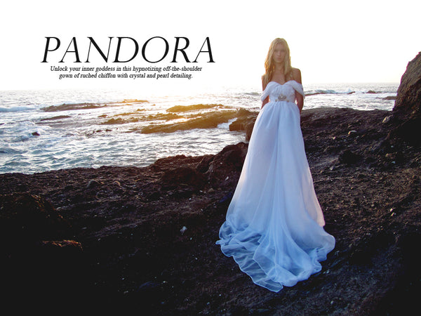 Off-the-shoulder ruched chiffon a-line gown with swarovski crystal and pearl detailing. Shop Pandora by Lauren Elaine Bridal