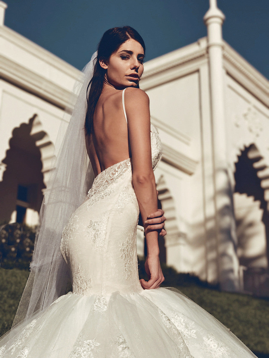 Arabelle backless mermaid lace wedding gown by Lauren Elaine bridal pictured in Ivory