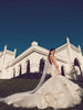 Dramatic mermaid wedding gown with lace and tulle cathedral train and cathedral veil.