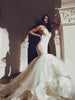 Glamorous designer mermaid wedding gown with tulle and lace cathedral train and horsehair hemline