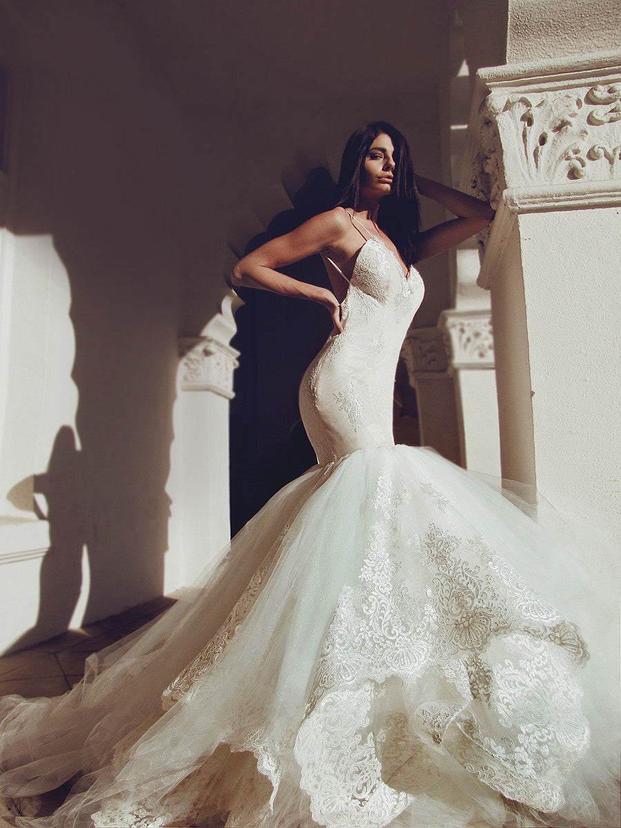 Glamorous designer mermaid wedding dress with tulle and lace cathedral train and horsehair hemline