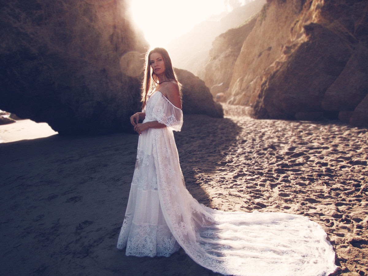 Off-the-shoulder bohemian lace wedding gown with cathedral lace train by Lauren Elaine Bridal