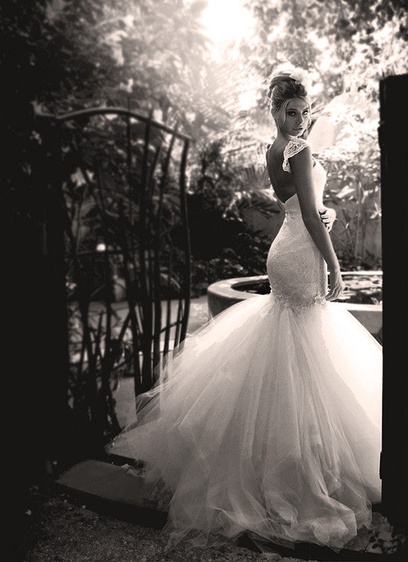 Lauren Elaine Aurelia Gown. Backless Mermaid wedding gown with tulle & lace.