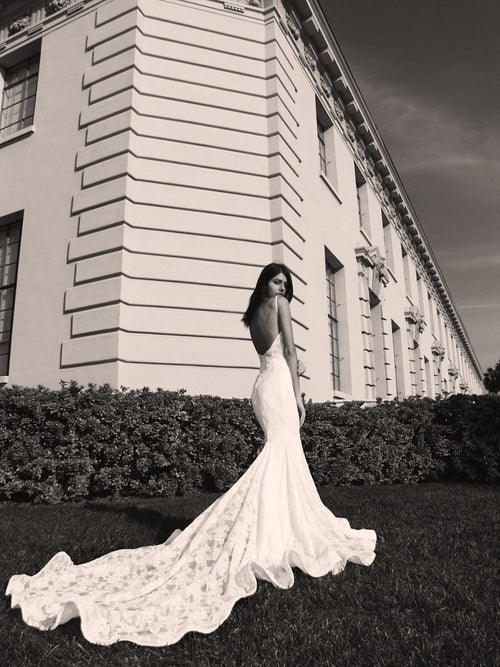 Backless lace mermaid wedding gown with cathedral train and kick pleat details by Lauren Elaine