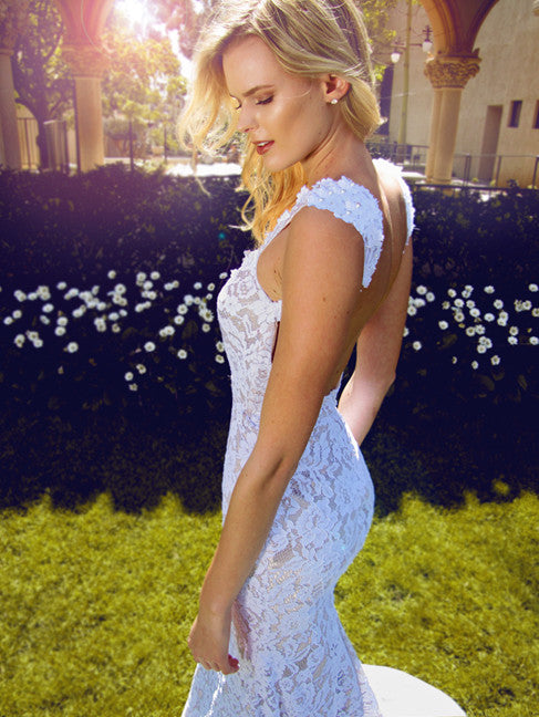 Sexy capped sleeve lace wedding dress with open back. Amara by Lauren Elaine Bridal.