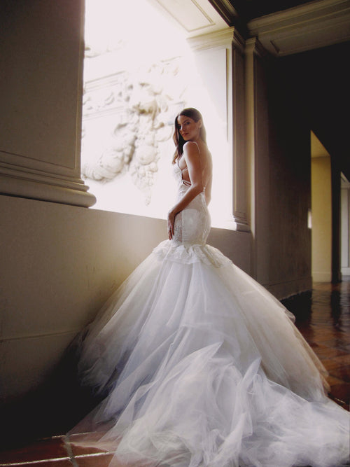 Backless mermaid wedding gown with detachable train and lace-up back