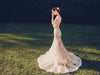Blushing nude illusion mermaid wedding dress with lace train and sweetheart bodice with spaghetti straps