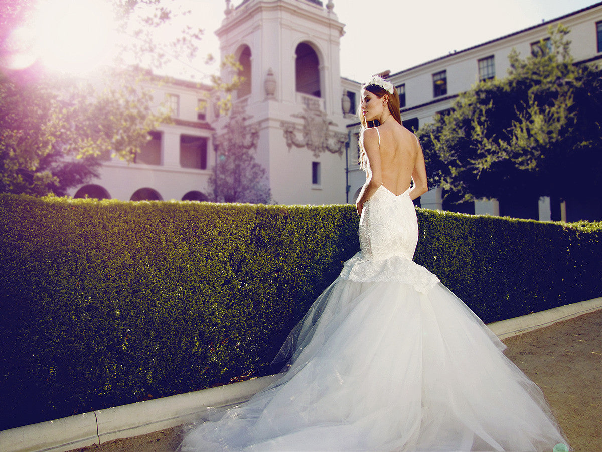 Backless mermaid wedding gown with cathedral train and spaghetti straps