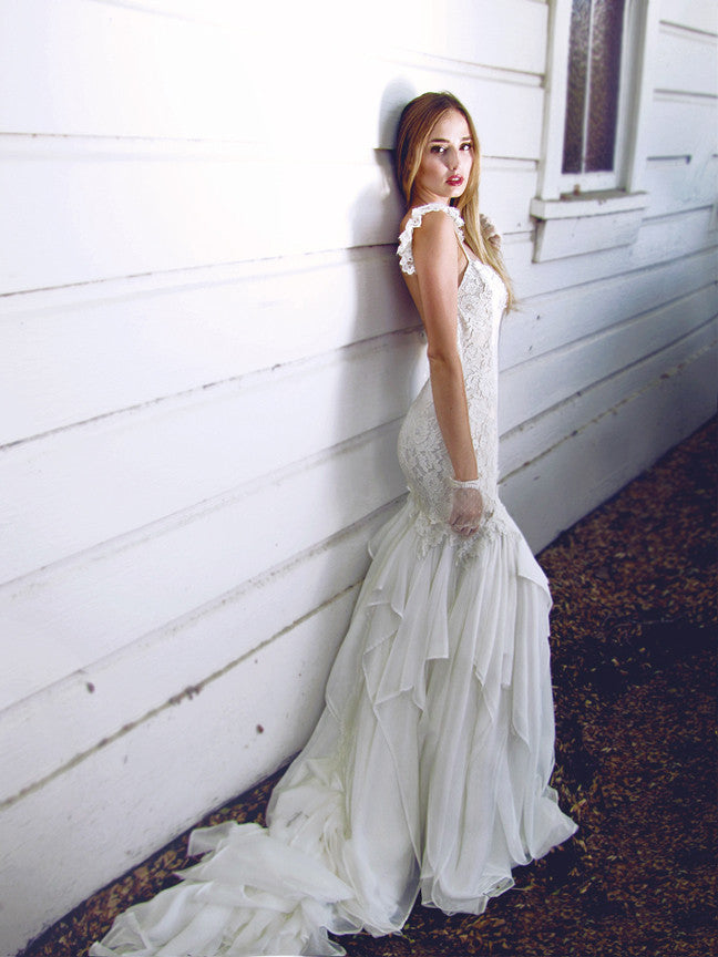 Chiffon and lace backless mermaid wedding gown by Lauren Elaine. Romantic and bohemian lace ruffle sleeves and chiffon petal train.