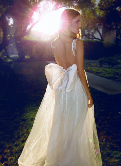 Open back wedding gown with oversize bow. Tulle and Lace.