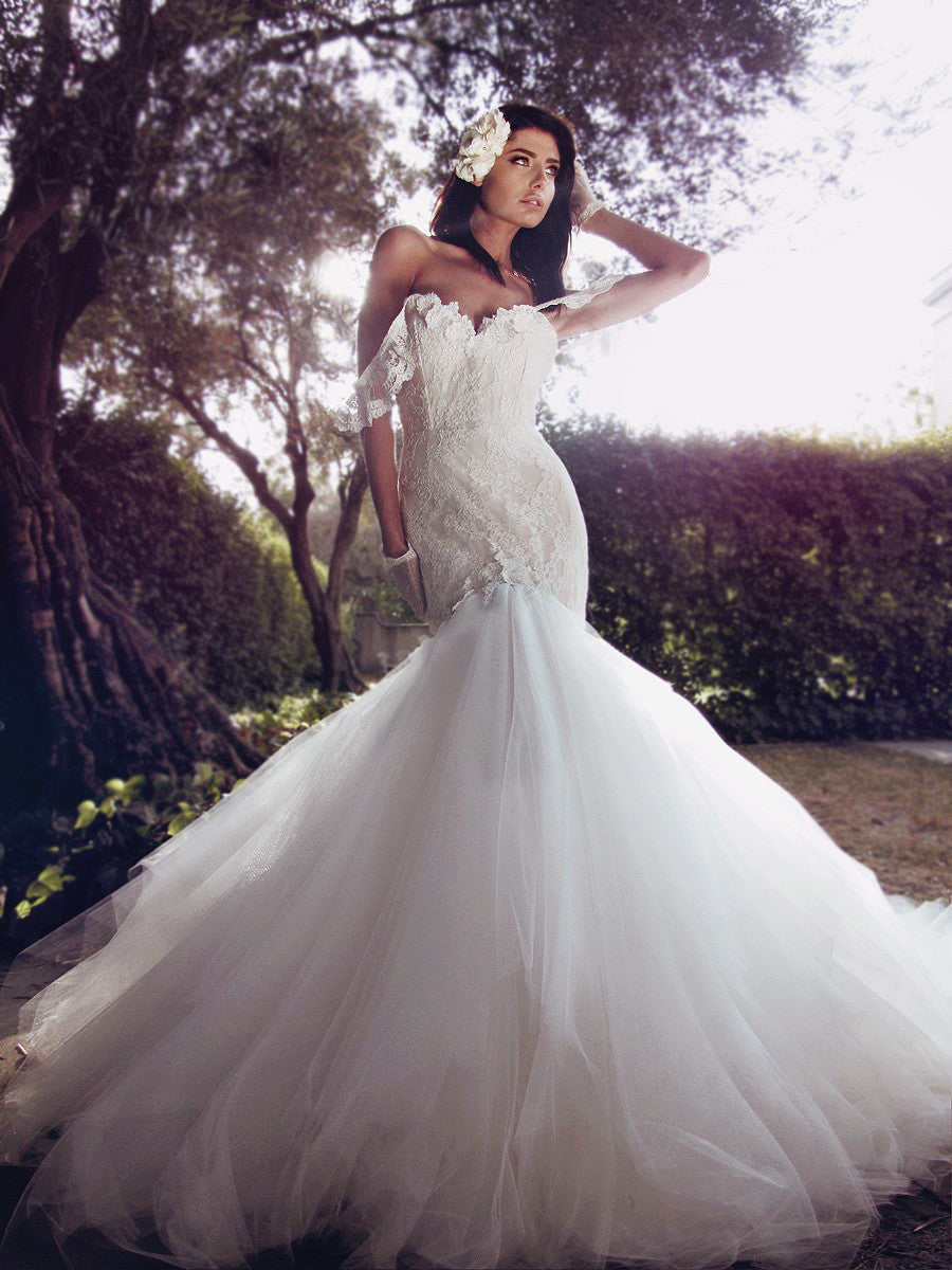 Off-the-shoulder mermaid wedding gown with lace appliqué detailing and cathedral tulle train