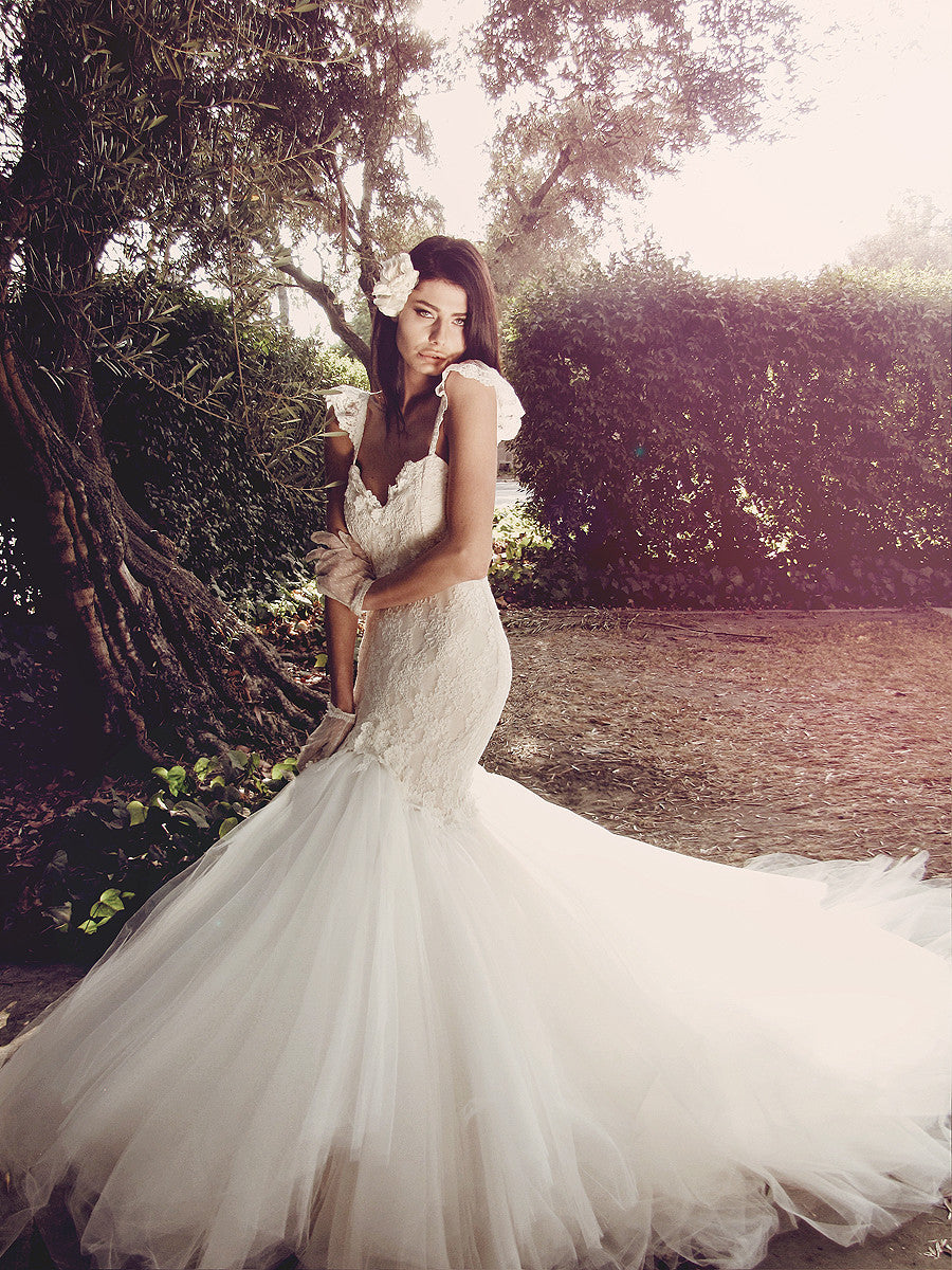 Romantic lace mermaid wedding gown with sweetheart neckline and lace spaghetti straps