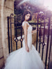 Backless illusion mermaid wedding gown with sheer nude blush underlay and fitted sweetheart corset bodice
