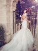 Backless mermaid wedding gown with cathedral train and ruffle sleeves