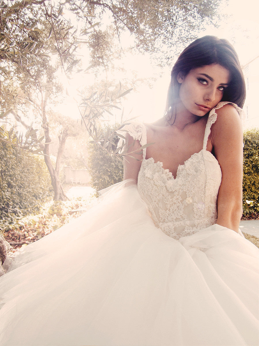 Romantic ethereal mermaid wedding gown with lace ruffle sleeves and flowers