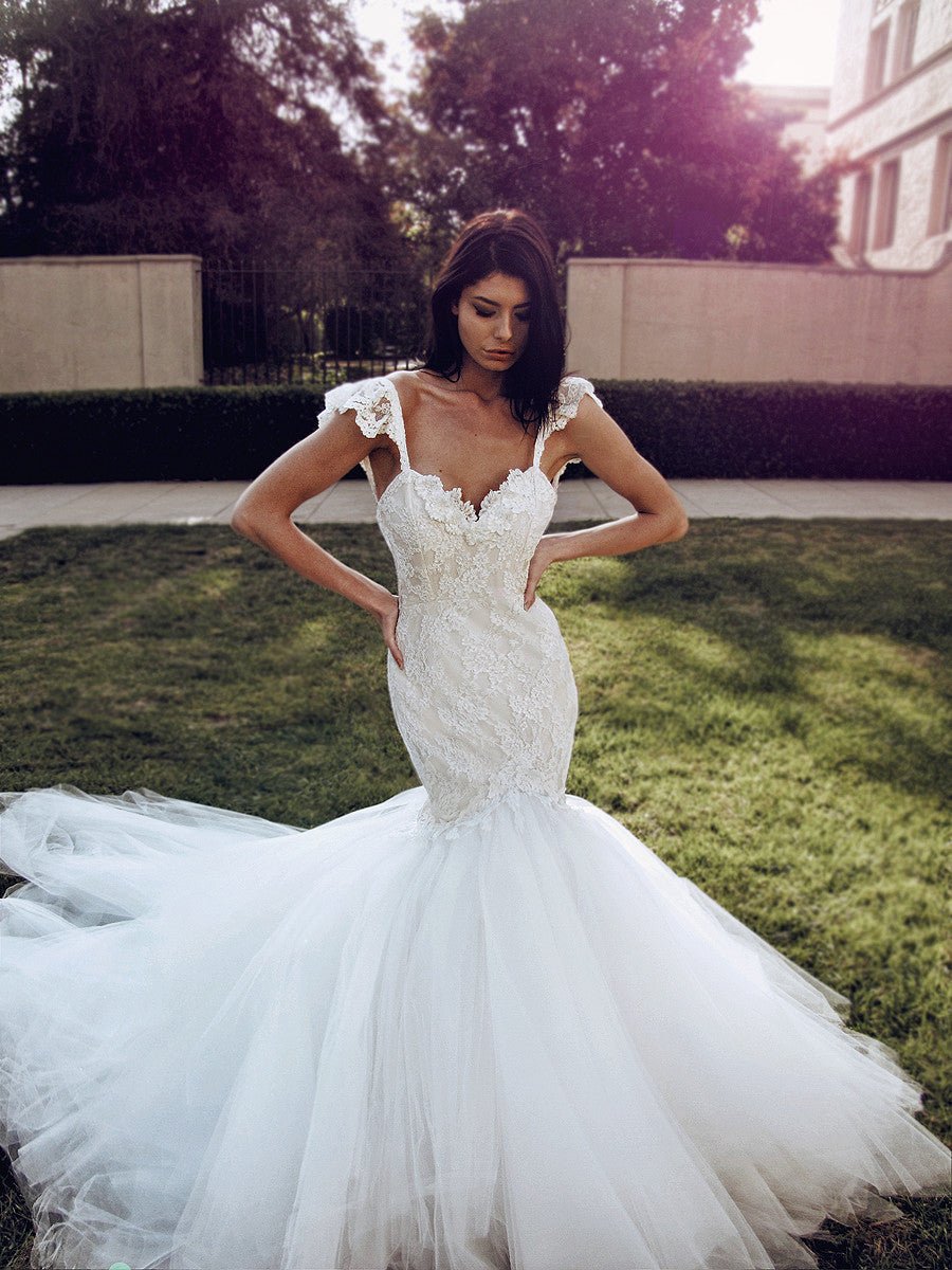 Sexy form-fit lace mermaid wedding gown with sweetheart bodice and cathedral train