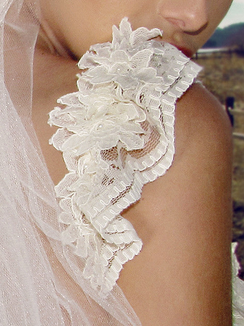 Ruffled lace cap sleeves with corded french lace flowers and pearl beads. Lauren Elaine Camellia Bridal Gown.