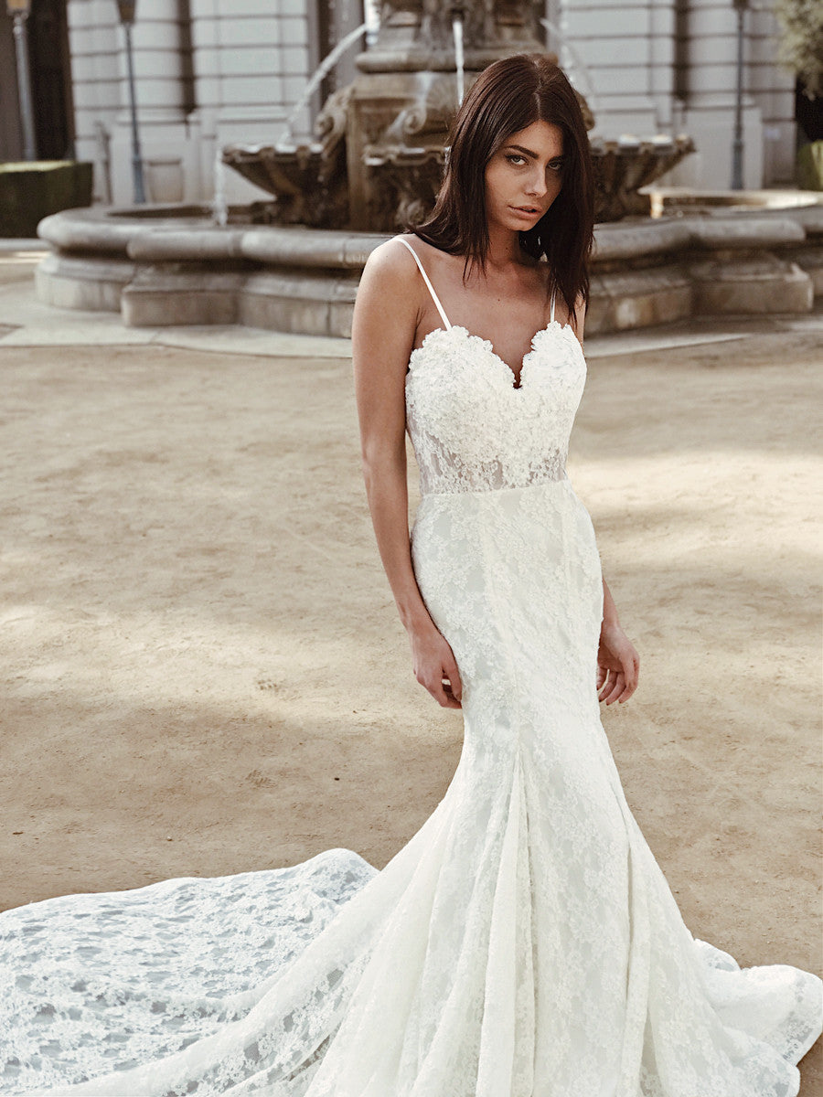 Sexy sweetheart illusion naked wedding gown with floral appliqués and spaghetti straps by Lauren Elaine Bridal.