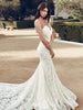 Lace mermaid trumpet wedding gown by Lauren Elaine Bridal with cathedral train and kick pleats.