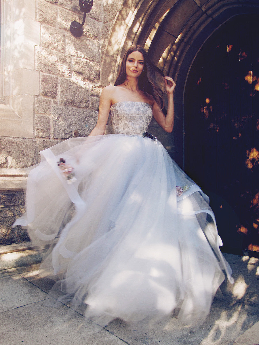 "Twirl-worthy ""Fleur"" wedding gown by Lauren Elaine Bridal in pewter mist blue shade with horsehair petals and flowers on skirt."