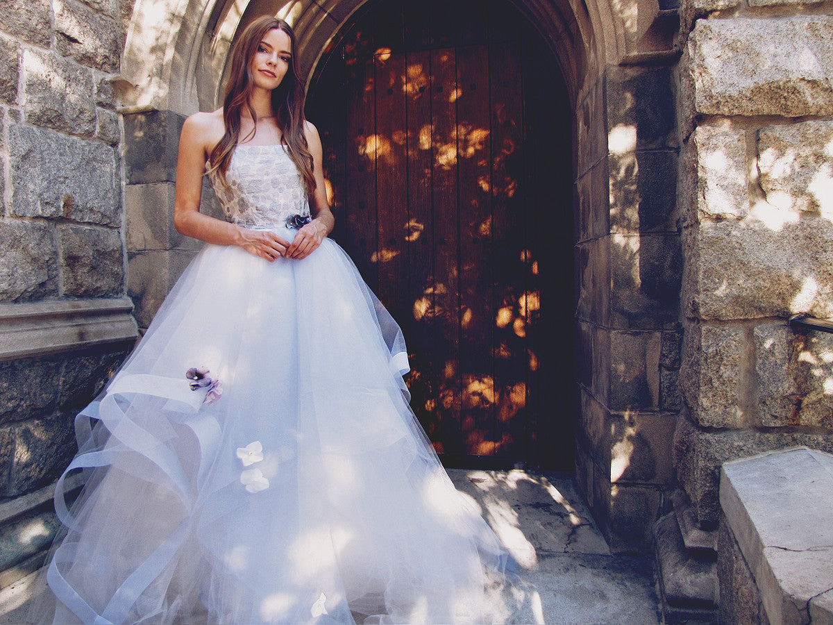 "Lauren Elaine ""Fleur"" wedding gown with blue tulle skirt and horsehair petals. Crystal and pearl beading and flowers on skirt."