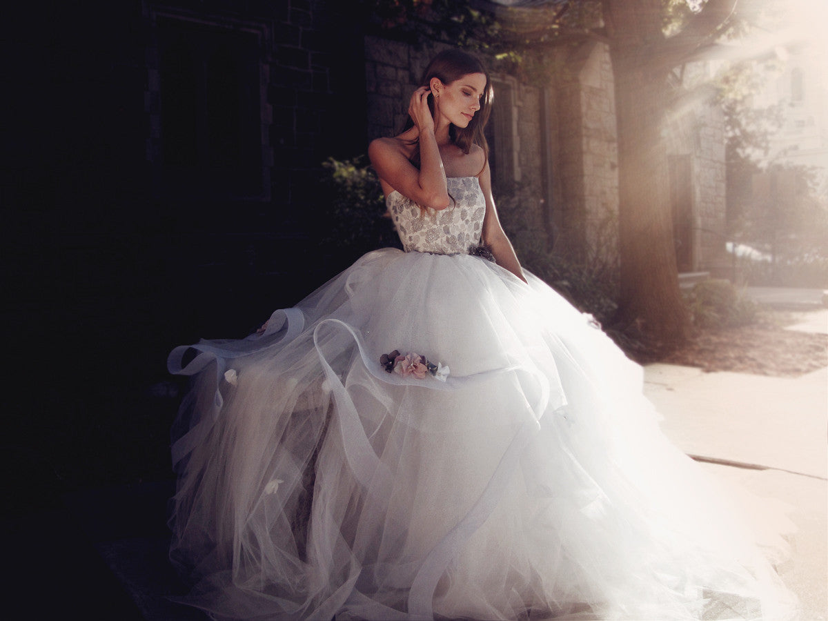 Ethereal and bohemian ball gown wedding dress in pewter mist blue with rainbow flowers and strapless corset bodice.