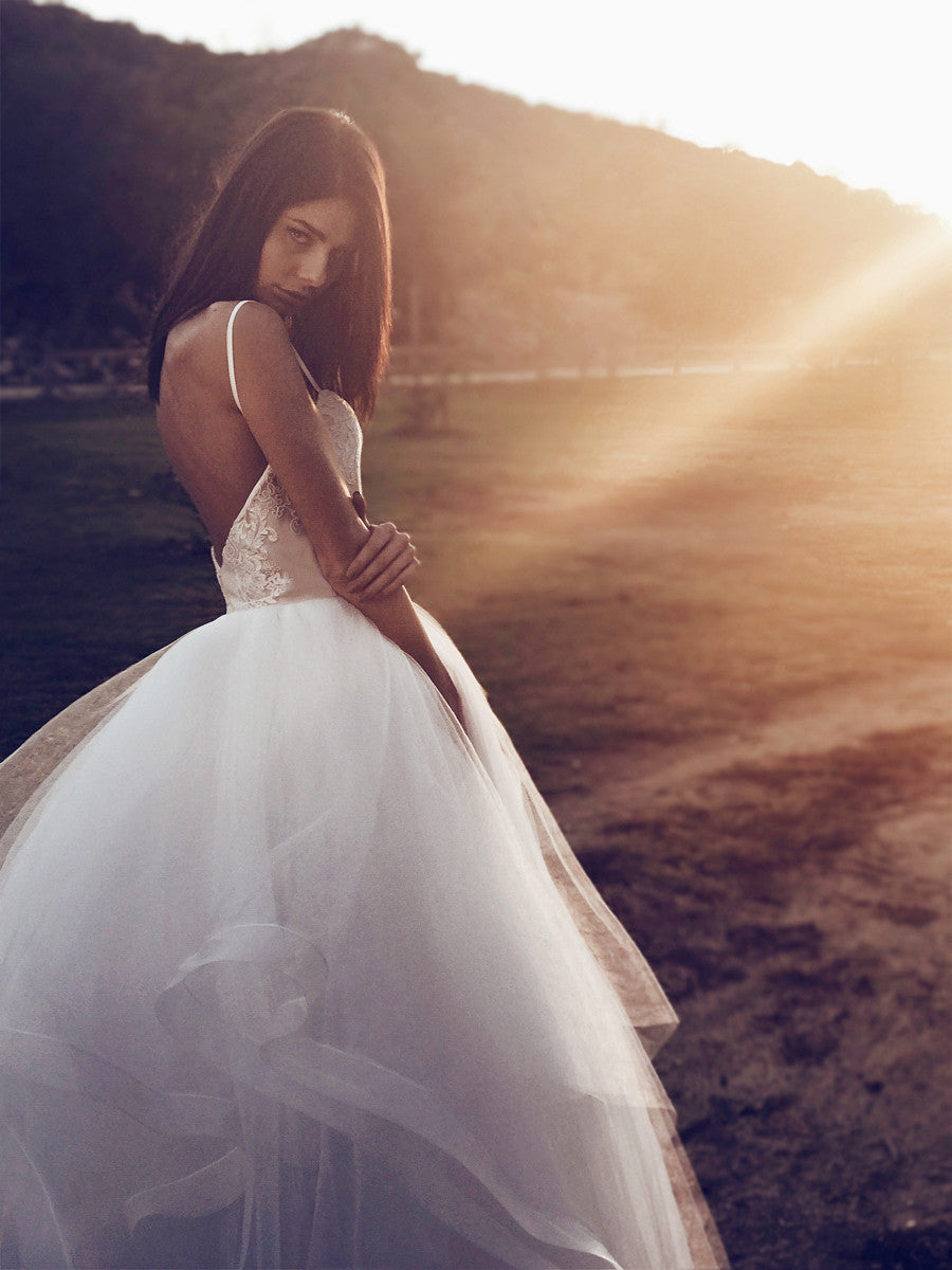 Open back tulle and horsehair wedding dress ball gown with spaghetti straps and layered twirl skirt