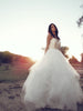 Classic tulle ball gown princess wedding dress with horsehair petals and sweetheart bodice.