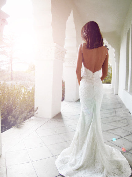 Backless lace wedding gown with train and satin-covered buttons. Isla by Lauren Elaine Bridal.