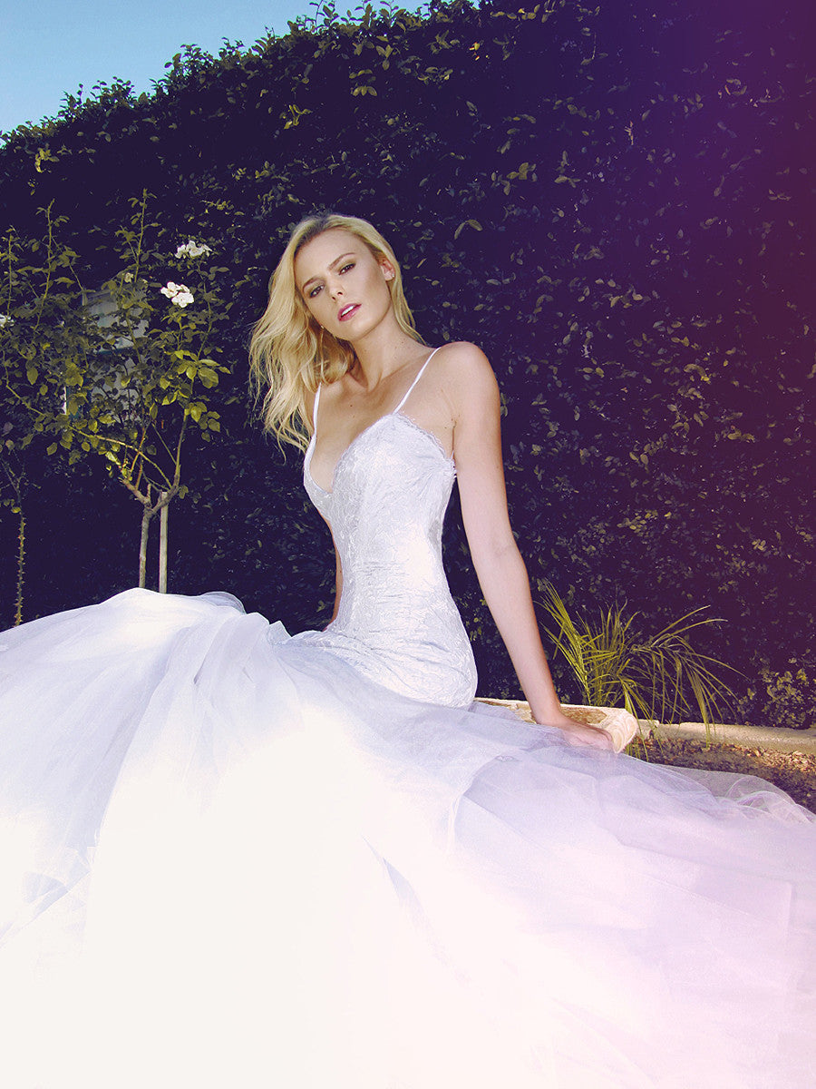 Tulle mermaid trumpet wedding gown with alencon lace and open back.
