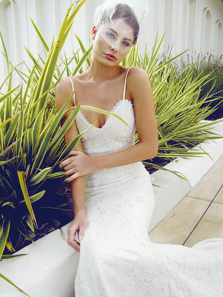 Designer lace wedding gown with plunging sweetheart bodice.