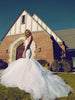 Mermaid wedding gown with detachable cathedral train and dramatic open back silhouette.