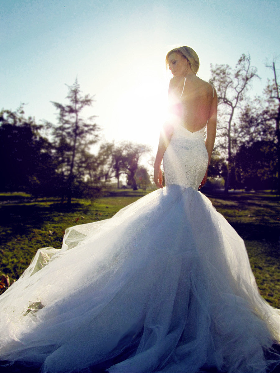 Backless mermaid wedding gown with detachable cathedral train.