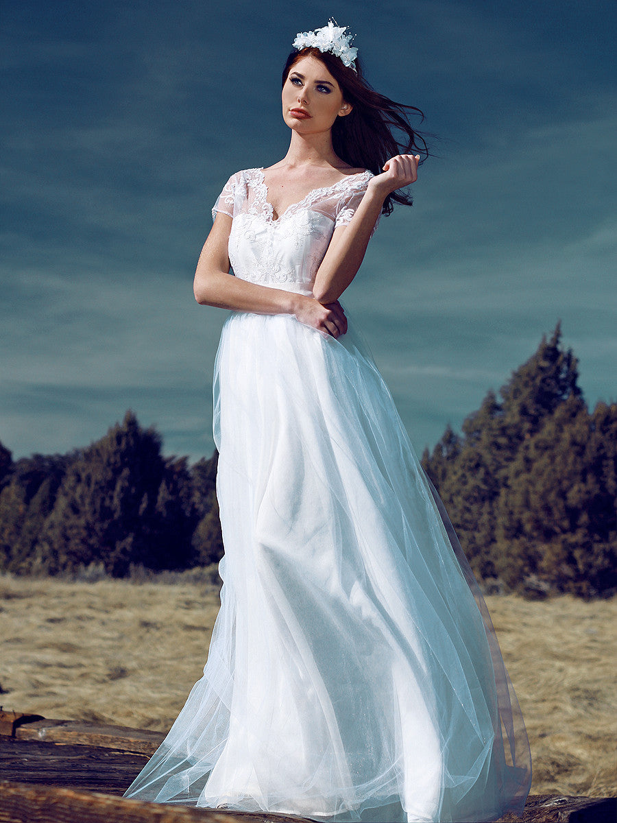 A-line tulle and lace illusion sleeve wedding gown. Briar Rose by Lauren Elaine.