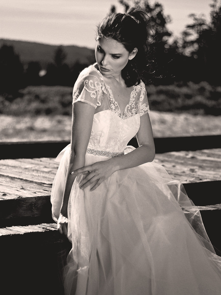 Scalloped scroll lace illusion gown with eyelash trim. Backless bridal gown.