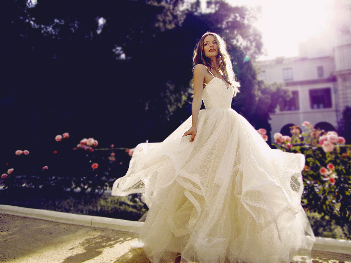 Twirling in the Magnolia wedding dress by Designer Lauren Elaine