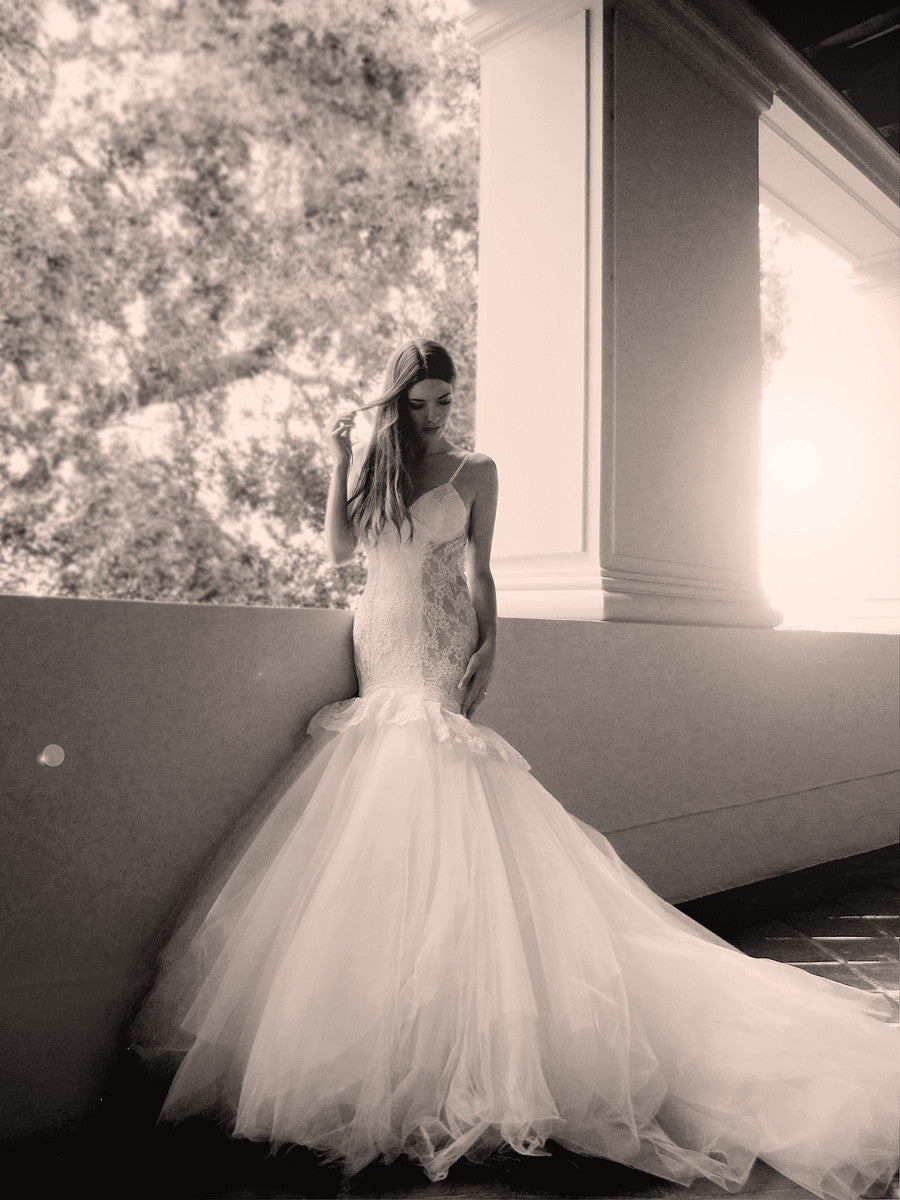 Lace mermaid wedding gown with peplum detailing and tulle skirt with cathedral train