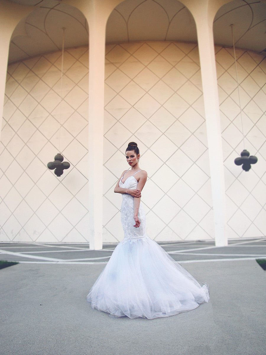 Lauren Elaine Anastasia bridal gown. Dramatic mermaid gown with open back design.