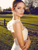 Vintage backless bridal gown with lace sleeves and train. made in the usa.