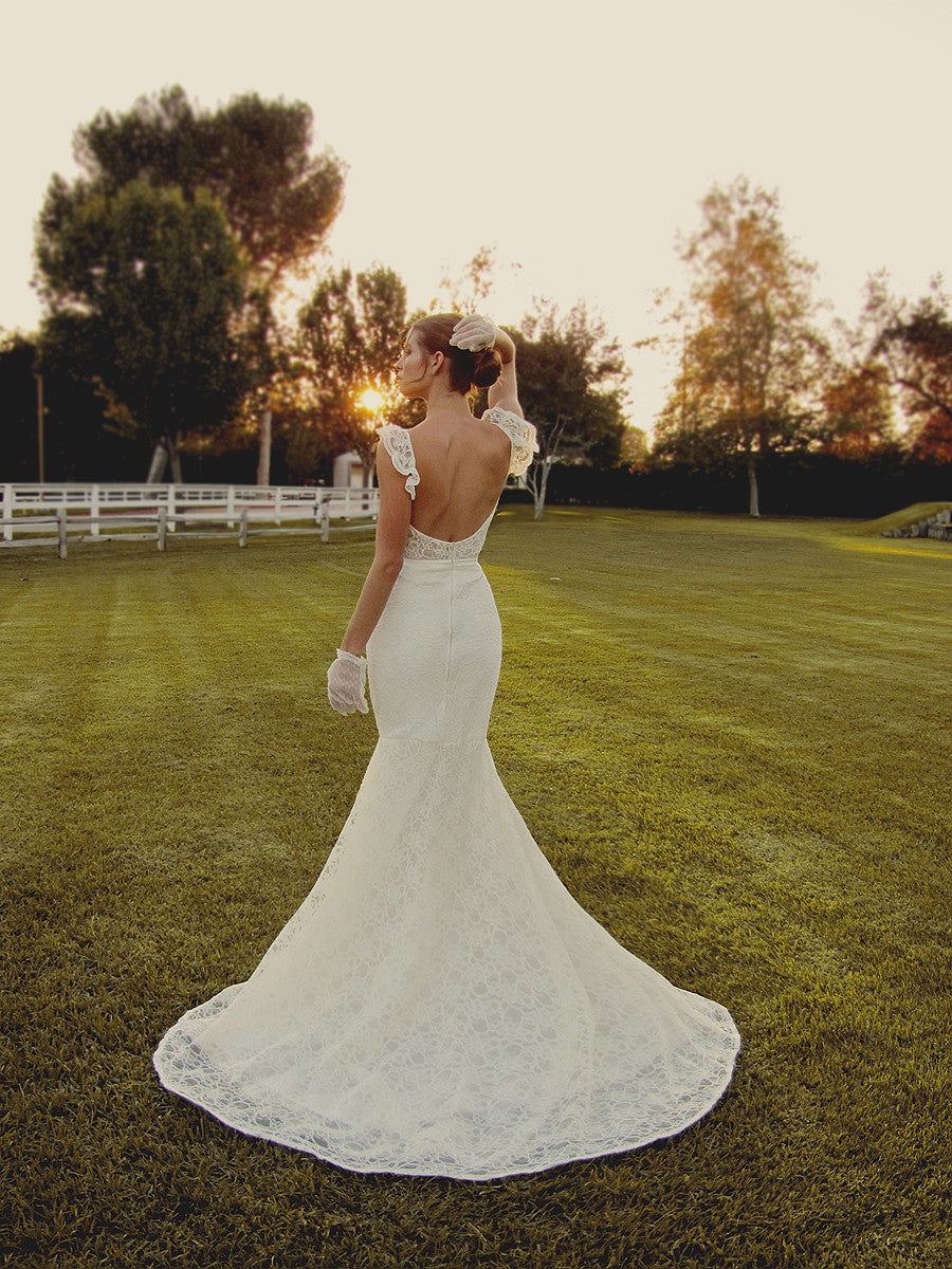 backless trumpet mermaid french lace illusion bridal gown with cap sleeves