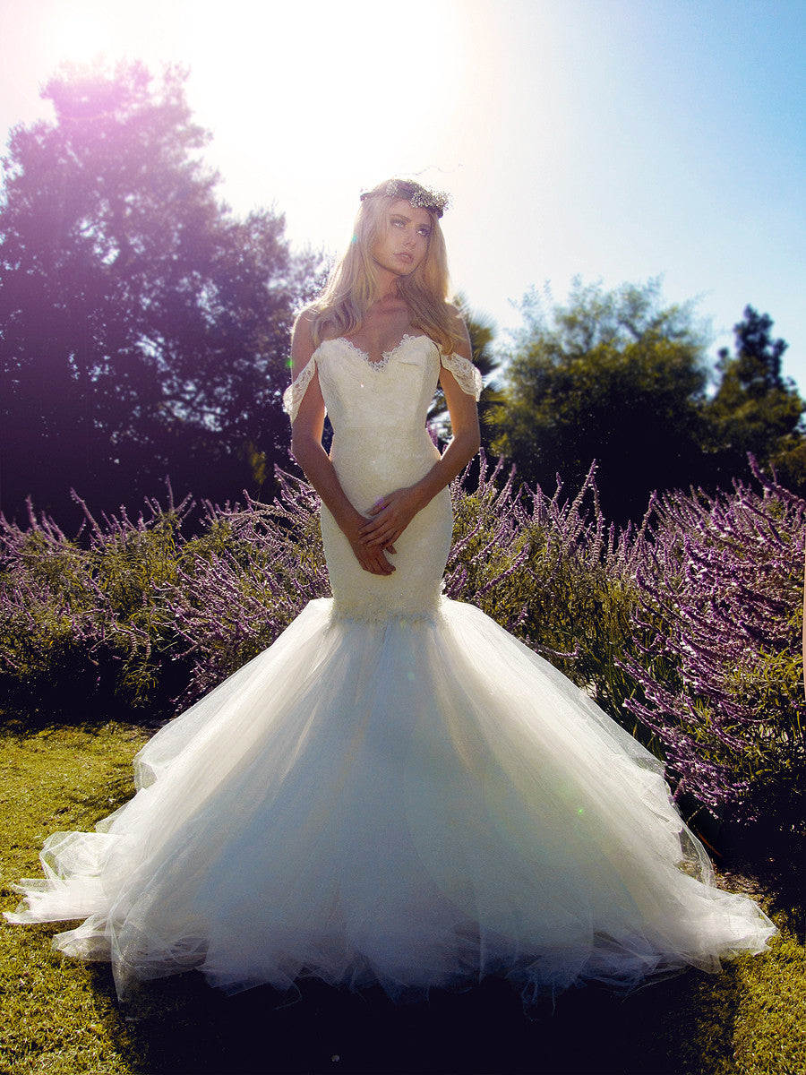 Off the shoulder mermaid lace wedding gown with tulle cathedral train.