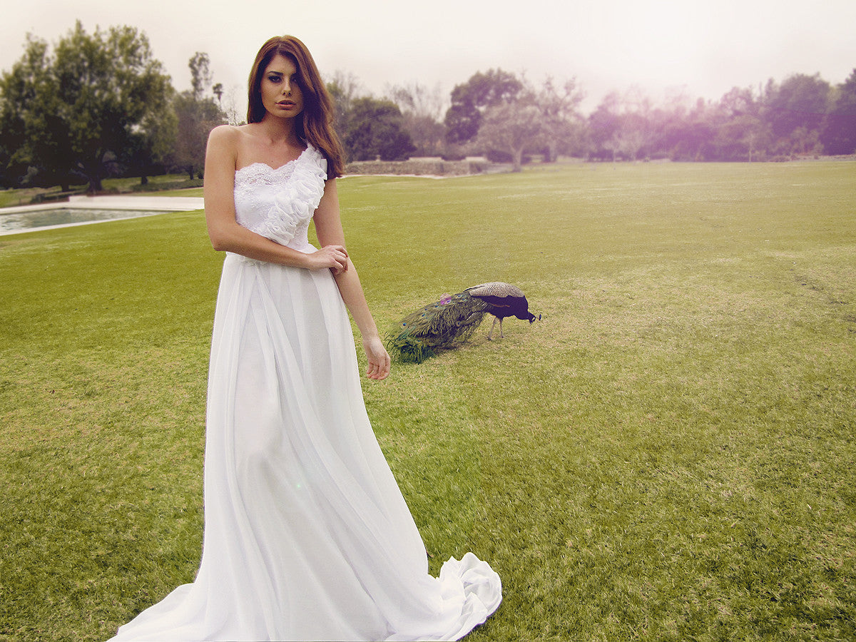 Lace and pearl wedding gown by Lauren Elaine Bridal. One-shoulder dress with ruffles. As seen on the red carpet.