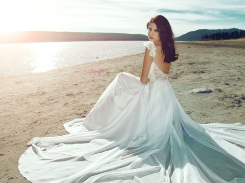 Flowing A-line chiffon and lace draped wedding dress. Illusion backless wedding gown.